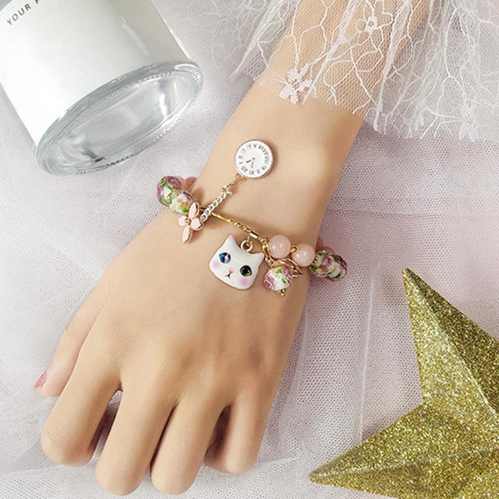 愛らしい表情の白猫チャームが超かわいい♡花と時計の白猫チャーム★ピンクビーズ ブレスレット