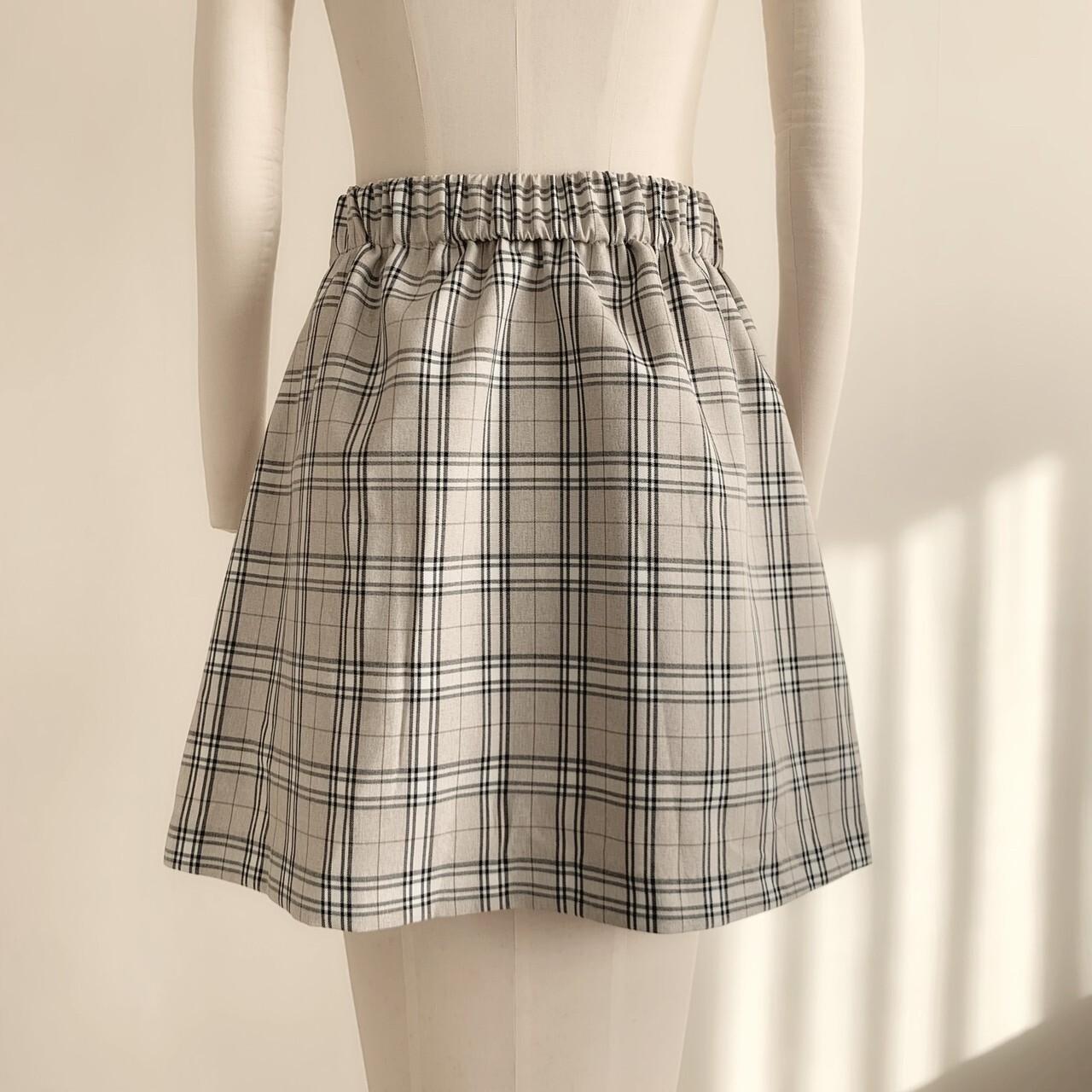 【meltie】london check button skirt