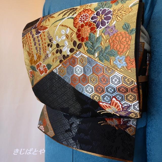 正絹 黒地に季節の花々と吉祥文様の袋帯