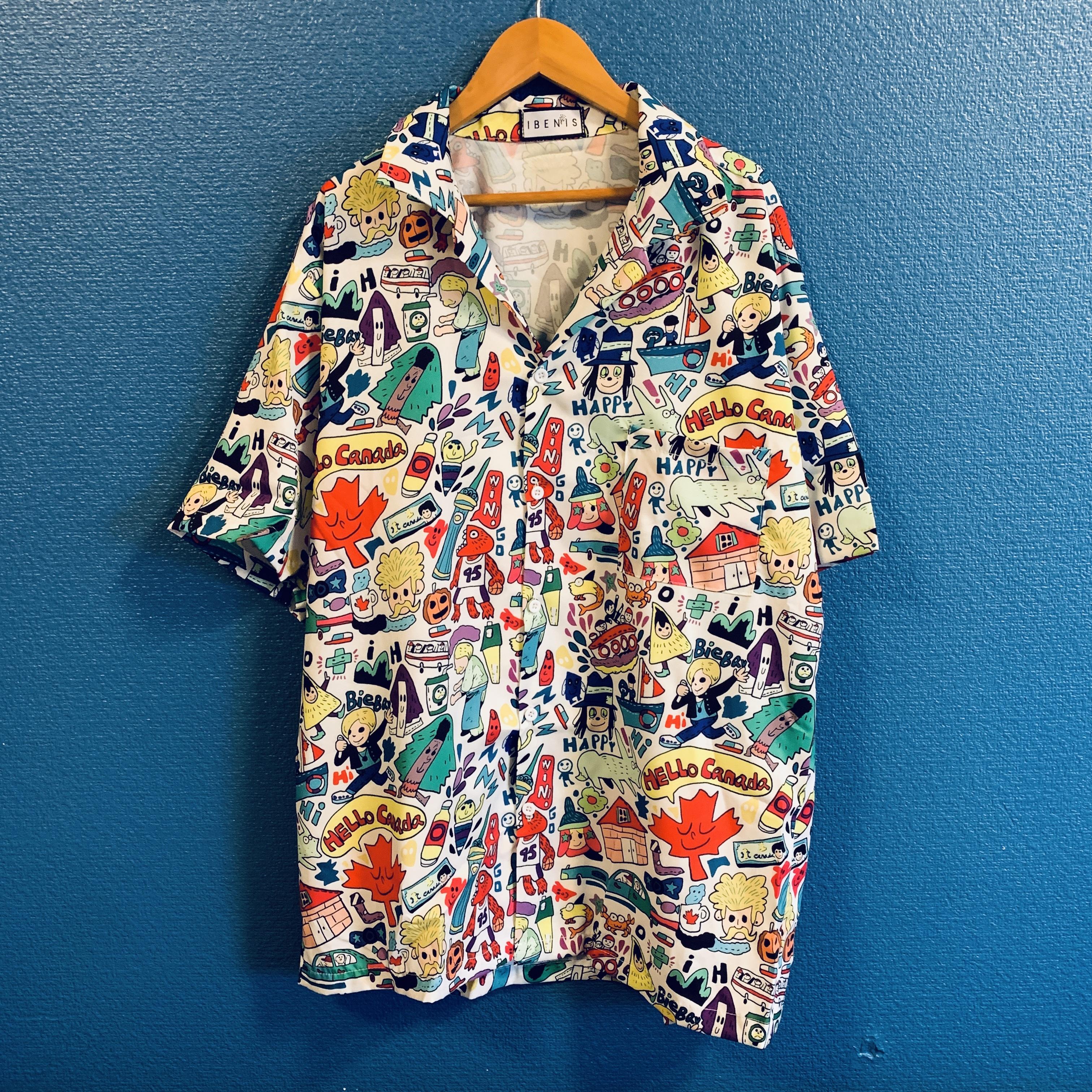 カラフルハッピーイラストのアロハシャツ