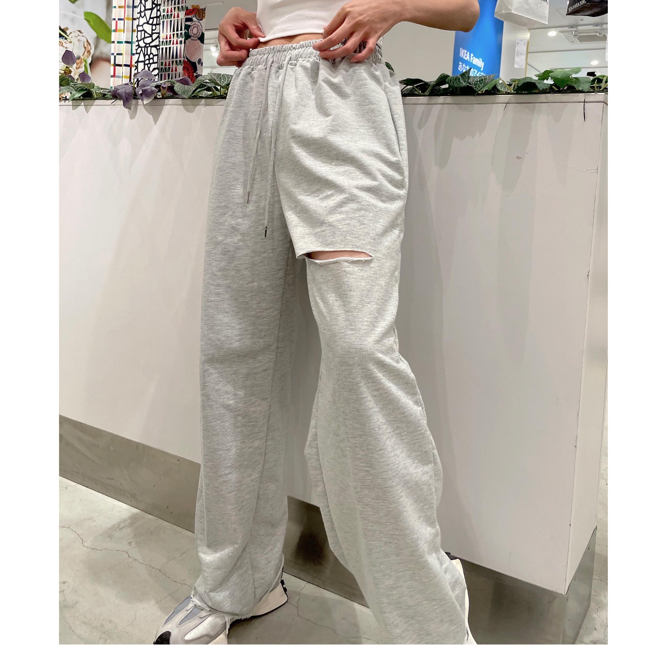 Damage cut sweat pants