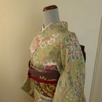 正絹紬 淡いベージュに意匠化された花模様 袷の着物