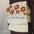正絹ひげ紬 白地に唐花のつくり帯