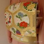 正絹 亀甲に季節の花の袋帯