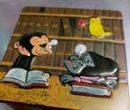 サルくんの居眠り図書缶