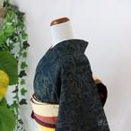 正絹紬 黒地に苅安色の織りの小紋 袷