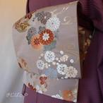 正絹 鳩羽鼠に季節の花の袋帯