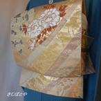 正絹 ピンクゴールドに季節の花々と鶴の袋帯