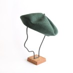 mature ha./beret top gather big green