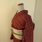 正絹紬 臙脂色に織り模様 袷の着物