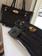 M.U.L  clutch bag