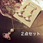 ピンク土星のネックレス&ピアスorイヤリングセット
