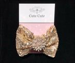 cute cute スパンコールゴールドリボンヘアクリップ キュートキュート