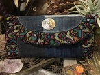 denim patchwork × tribal ruffle clutch bag