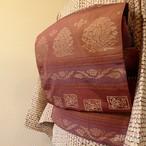 正絹 紅鳶色に唐花の開きなごや帯