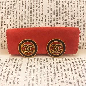 CHANEL black × gold logo earrings