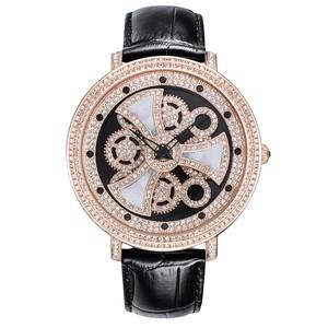 マザーオブパールのモチーフが回転 DAVENAダヴェナ腕時計フォルマ forma 黒/ピンクゴールド スワロフスキークリスタル使用