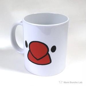 文鳥がこちらを見ているマグカップ