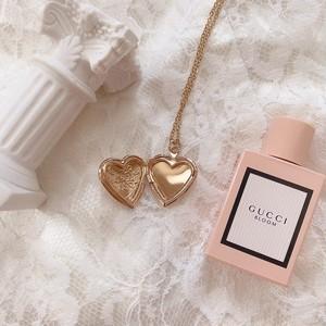 Flower heart locket necklace