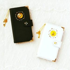 手帳型スマホケース『うさぎと月への扉 -BlackDoor or WhiteDoor-』カメラ穴、ポケット付き。ほぼ全機種オーダー可能、期間限定英字名入れ無料