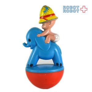 青い象に乗ったおむつの赤ちゃん おきあがりこぼし ガラガラ