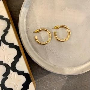 gold hoop pierce