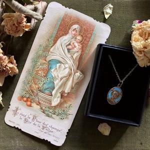 聖母子のホーリーカードとルルドのメダイ