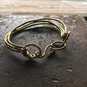 Three brass bangles