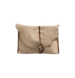 Concho beige clutch