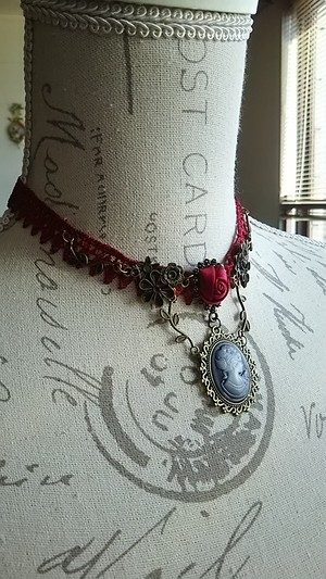 Red cameo choker