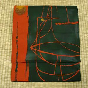 黒地に緑と赤のぼかし織りに鶴と月 袋帯