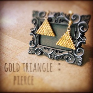 gold triangle:pierce
