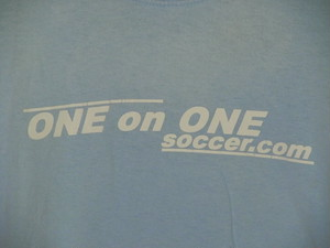 USA古着プリントTシャツM水色ONE on ONEサッカー両面 綿ダメージ