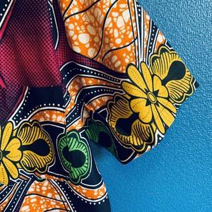 アフリカンテキスタイルシャツ(オレンジフラワーサイケ)