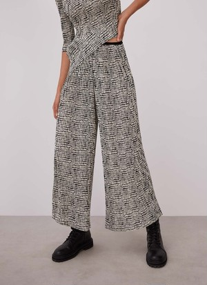 CRINKLE TROUSERS WITH SIGNATURE PRINT