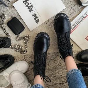 white stitch boots