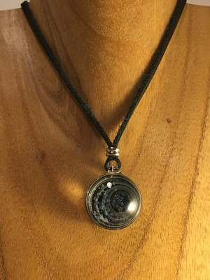spacey coin pendant