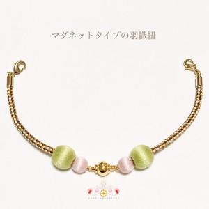 マグネットタイプの羽織紐-黄緑と桜-