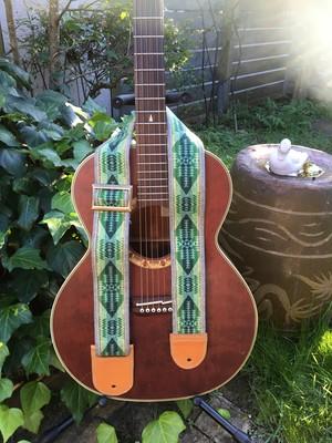 Ortega's guitar strap (green)