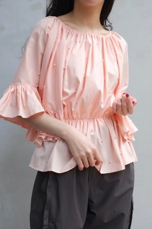 pink pearl blouse.
