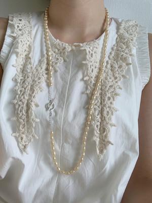 Enasoluna sow  Long glass pearl necklace