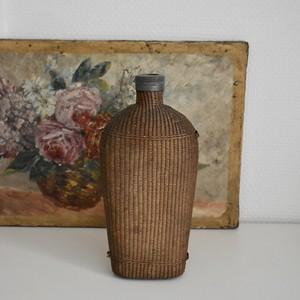 Wicker woven bottle M
