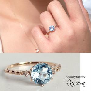 nt66r-bt-d 存在感のあるブルートパーズにダイヤモンド2石を添えたクラウンアラベスクデザインK10イエローゴールド華奢リング