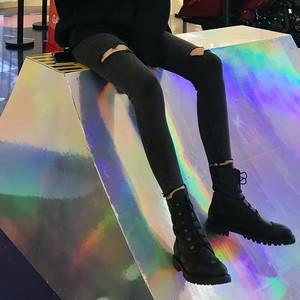 knee damage black skinny pants
