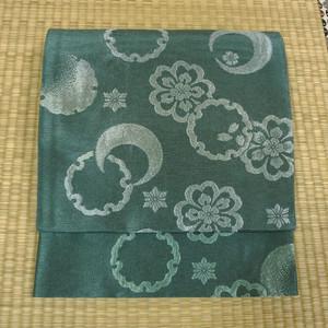 渋めの山藍摺色に桜や雪輪 京袋帯