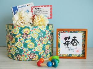 7つのていねい。名言おむつケーキdayoraシリーズ【緑花柄和紙×イエロー系コサージュ】【出産祝いおむつケーキ/和風】