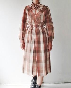 BEIGE CHECKED DRESS.