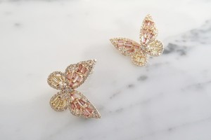 pink papillon pierce
