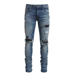 AMIRI MX1 Leather Patch Jeans  Medium Indigo