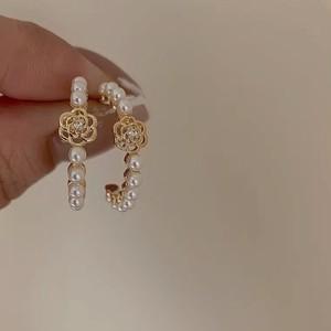 camellia ring pierce